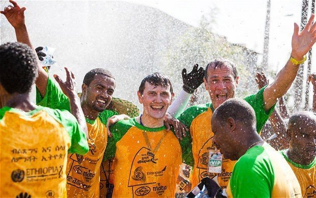 Home, but not dry: Michael Kerr, (third from left), lays some running ghosts to rest in Ethiopia
