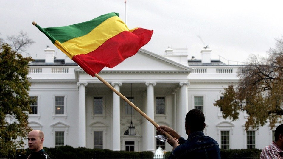 A demonstrator waves an Ethiopian flag outside the White House to protest mistreatment of opposition leaders in their homeland on Nov. 15, 2005.