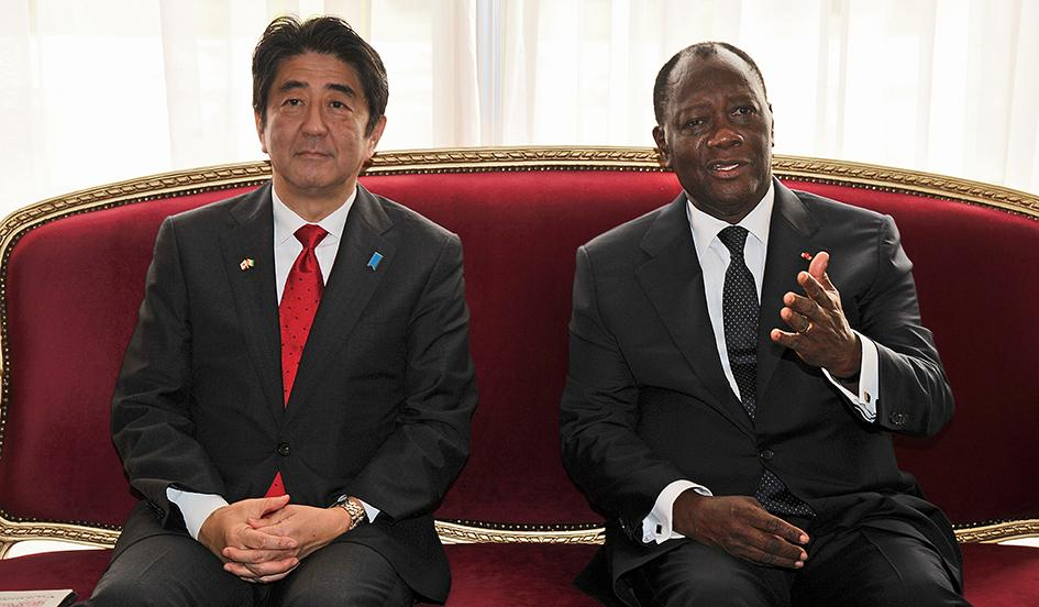 Ivory Coast's President Alassane Ouattara, right, meets Japanese Prime Minister Shinzo Abe on Jan. 10, 2014. Issouf Sanogo/AFP/Getty
