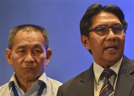"Malaysia's Department of Civil Aviation director general Azharuddin Abdul Rahman, right, speaks as Malaysia Airlines Group Chief Executive Ahmad Jauhari Yahyain listens during a press conference at a hotel in Sepang, Malaysia, Monday, March 10, 2014. Dozens of ships and aircraft have failed to find any piece of the missing Boeing 777 jet that vanished more than two days ago above waters south of Vietnam as investigators pursued ""every angle"" to explain its disappearance, including hijacking, Malaysia's civil aviation chief said Monday. (AP Photo)"