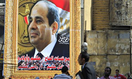 People walk past a banner for Egypt's Abdel Fattah al-Sisi in downtown Cairo. Photograph: Mohamed Abd El Ghany/REUTERS