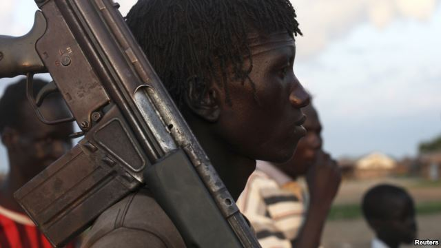 FILE - A man from the Luo Nuer tribe carries his gun in Yuai Uror county, South Sudan.