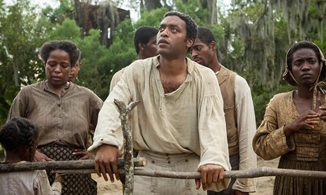 Chiwetel Ejiofor, centre, in a scene from 12 Years a Slave. Photograph: Jaap Buitendijk/AP