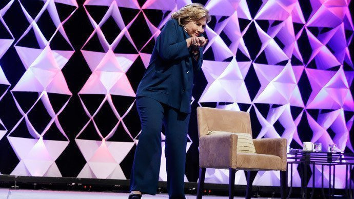 Former Secretary of State Hillary Clinton ducks after a woman threw an object toward her while she was delivering remarks at the Institute of Scrap Recycling Industries conference on April 10, 2014 in Las Vegas, Nevada.(AFP Photo / Isaac Brekken)
