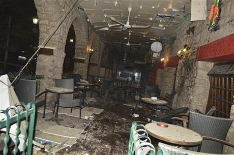 The interior of the La Chaumiere restaurant which was the scene of a Saturday night attack, in the capital Djibouti city, Djibouti on Sunday, May 25, 2014. The European Union Naval Force and the African Union on Sunday both condemned an attack the government said involved two Somali suicide bombers in the tiny East African nation of Djibouti. At least three people were killed, including a male and female suicide bomber, and over a dozen wounded in an attack on a restaurant popular with Westerners in central Djibouti, local media said today. (AP Photo)