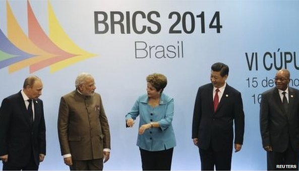 The leaders of the so-called BRICS countries - Brazil,  Russia, India, China and South Africa - sign a deal to create a new $100bn development bank and emergency reserve fund. BBC/Reuters