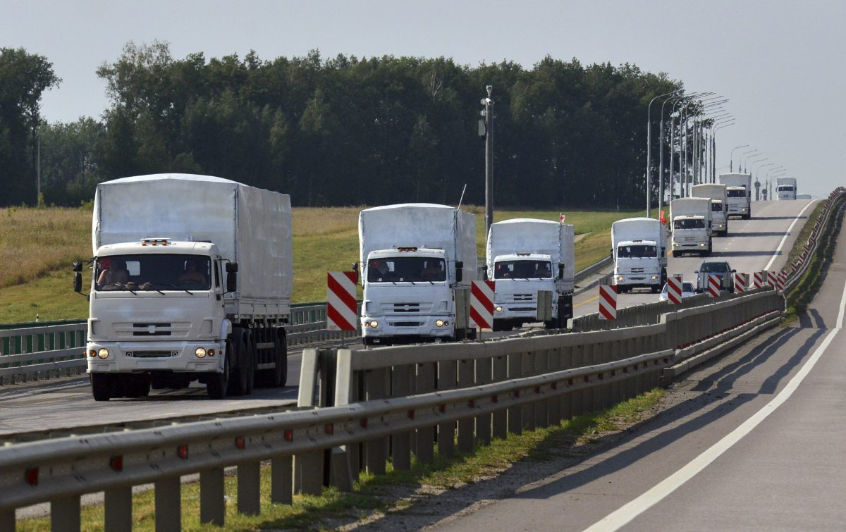 A Russian convoy of trucks carrying humanitarian aid for Ukraine drives along a road near the city of Yelets August 12, 2014 / Source Time.com