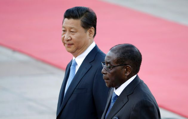 China's President Xi and Zimbabwe's President Mugabe attend a welcoming ceremony in Beijing. Image by: JASON LEE / REUTERS Source - Times Live