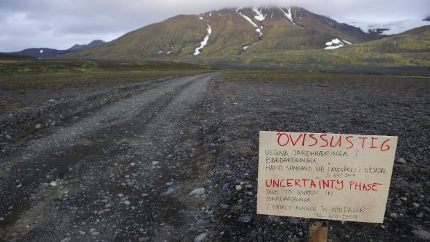 A warning sign blocks the road to Bardarbunga volcano. The threat of an eruption has increased, according to the Icelandic Meteorological Office, with 'intense seismic activity' and 'ongoing magma movement.' (Sigtryggur Johannsson/Reuters)