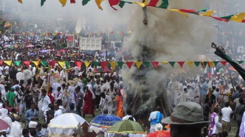 PHOTO: Ethiopians chanted and ran circles around a flaming pyre in the People's Square of Gondar in celebration of the Meskel Festival. (Photo by David Cogswell)