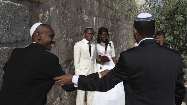 Illustrative photo of an Ethiopian Jewish couple seen posing for a wedding photographer next to the Old City Walls in Jerusalem. (photo credit: Nati Shohat/Flash90)