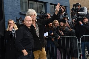 Midge Ure, left, and Bob Geldof arrive at a London studio for the remake of the first Band Aid single from 1984. Photo / AP