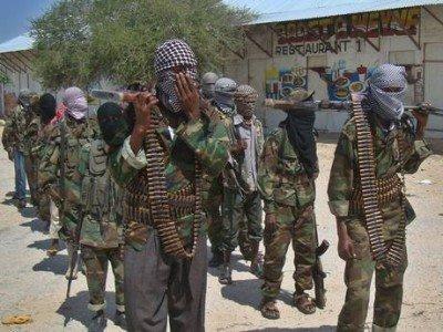 Al-Qaeda linked al-shabab recruits walk down a street in the Somalian capital, Mogadishu Source - The Independent
