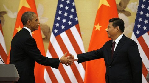 U.S. President Barack Obama (L) and Chinese President Xi Jinping shake hands at the end of their news conference in the Great Hall of the People in Beijing November 12, 2014 (Reuters / Kevin Lamarque)