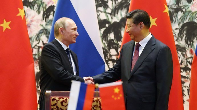 Russia's President Vladimir Putin (L) and his Chinese counterpart Xi Jinping. (AFP Photo/How Hwee Young