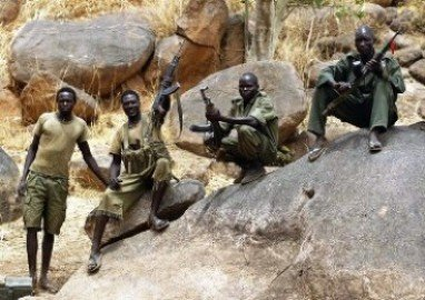 SPLM-N fighters hold up their rifles near Jebel Kwo village in the rebel-held territory of the Nuba Mountains in South Kordofan, May 2, 2012. (photo Goran Tomasevic Reuters)