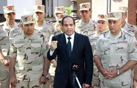 A picture released on October 25, 2014 the Egyptian Presidency shows Egypt's President Abdel Fattah al-Sisi (C), surrounded by top military generals, addresses journalists following an meeting of the Supreme Council of the armed Forces in Cairo (AFP Photo/)