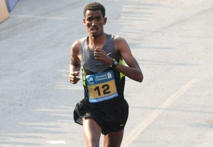 Ethiopia's Tesfaye Abera about to breast the tape to win the 12th Standard Chartered Mumbai Marathon men's race. Photo: Vivek Bendre