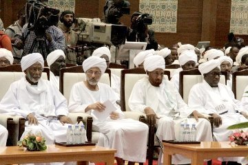 From left to right: Leader of the Popular Congress Party (PCP) Hassan Al-Turabi, Reform Now Party (RNP) head Ghazi Salah Al-Deen Al-Attabani, National Umma Party (NUP) Al-Sadiq Al-Mahdi and second vice-president Hassabo Abdel-Rahman attend a speech by the president announcing a national dialogue initiative on 27 January 2014 (SUNA)