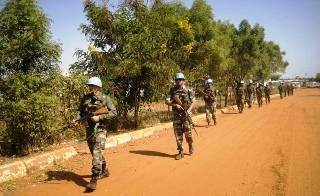 UNMISS troops from India patrol the perimeters of a compound in South Sudan's capital, Juba (AP)