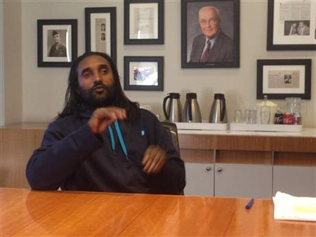 In this photo taken Feb. 27, 2015, Abreham Zemedagegehu, seated in a conference room of lawyer's office in Washington, discusses the lawsuit he filed against the Arlington, Va., sheriff in federal court. Zemedagegehu, a U.S. citizen who was born in Ethiopia, learned that he'd been accused of stealing an iPad _ an iPad whose owner later found it. He spent the next six weeks in jail, unable to communicate with his jailers because he is deaf. He described a frightening, isolated experience in which medical procedures were performed without his consent and he feared for his safety. (AP Photo/Matt Barakat)