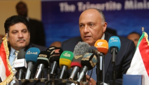 Egypt's Foreign Minister Sameh Shoukry speaks during a press conference with his Sudanese and Ethiopian counterparts in the Sudanese capital of Khartoum, March 6, 2015. (photo by ASHRAF SHAZLY/AFP/Getty Images)