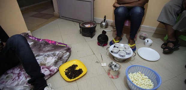 Exiled Ethiopian journalists perform a traditional coffee ceremony in a shared, cramped apartment in Nairobi. A wave of arrests prompted at least 30 Ethiopian journalists to flee into exile in 2014. (CPJ/Nicole Schilit)