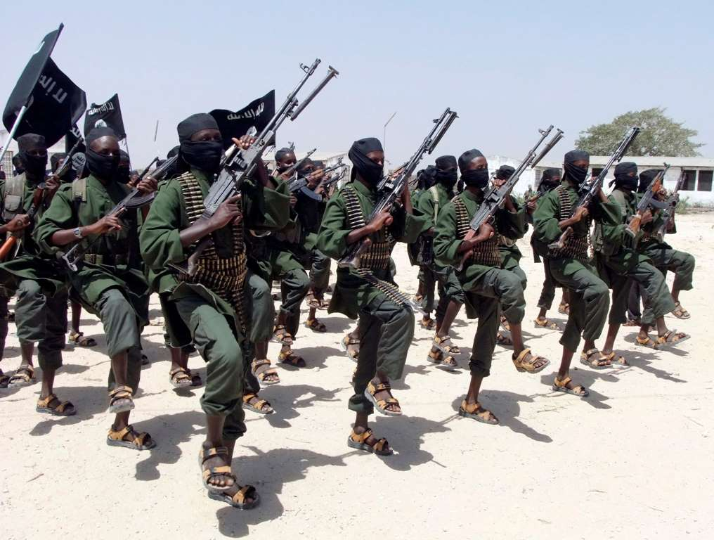 FILE - In this Thursday, Feb. 17, 2011 file photo, hundreds of newly trained al-Shabab fighters perform military exercises in the Lafofe area some 18km south of Mogadishu, in Somalia. Making a rare threat against the United States, a senior member of Somalia's Islamic insurgent group that has carried out terrorist attacks abroad said Thursday, May 22, 2014 that holy war will come to America and that Islam's flag will one day fly over Washington. (AP Photo/Farah Abdi Warsameh, File)