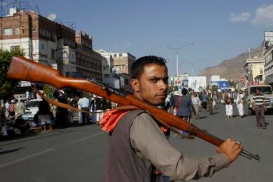 A Houthi Shiite rebel carries his weapon as he joins others to protest against Saudi-led airstrikes, during a rally in Sanaa, Yemen, Wednesday, April 1, 2015. (Photo AP/Hani Mohamed)