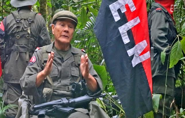 Colombian guerrilla group National Liberation Army (ELN) Commander Nicolas Rodriguez, known as ''Gabino'', gestures as he speaks in response to questions from Reuters at a hidden jungle camp in this still image taken from an undated video released April 23, 2015. Reuters/ELN/Handout via Reuters