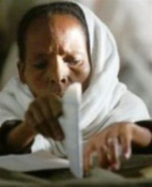 An Ethiopian woman casts her vote at a polling station in Addis Ababa, on Sunday, May 15, 2005 (AP Photo)