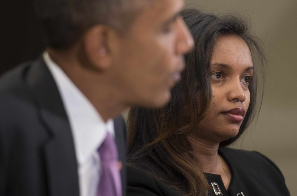"Ethiopian journalist Simegnish ""Lily"" Mengesha (R) sits with President Obama during a round table with persecuted journalist for World Press Freedom Day at the White House in Washington, DC, May 1, 2015. JIM WATSON/AFP/Getty Images"