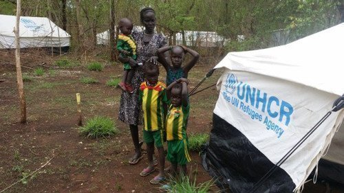 Nyadol Dak with her children in Jewi camp, among thousands of South Sudanese refugees being moved from flood-prone areas in the Gambella region to a new refugee camp in western Ethiopia.