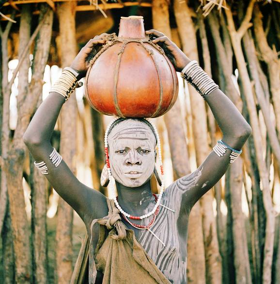 A Mursi woman from the Omo Valley carrying water / The Telegraph  Picture: Philip Lee Harvey