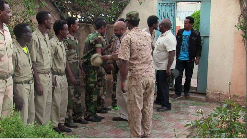Dr. Birhanu Nega and Neamin Zeleke greeting freedom fighters.  Photo Credit : ESAT joournalist Mesay Mekonen