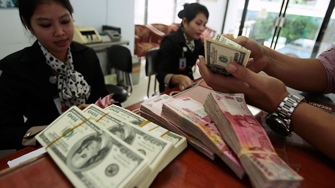 Indonesian ban on foreign currency payments comes into force