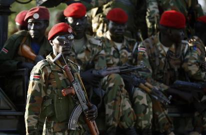 A SPLA soldier stands in front of a vehicle in Juba on December 20, 2013. (Photo Reuters/Goran Tomasevic) via Sudan Tribune
