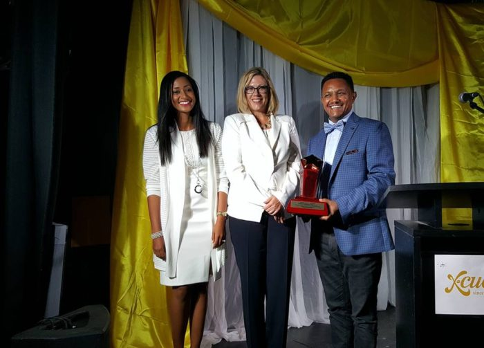 Teddy Afro with his award accompanied by his wife Amleset Muchie - and Winnipeg Mayor