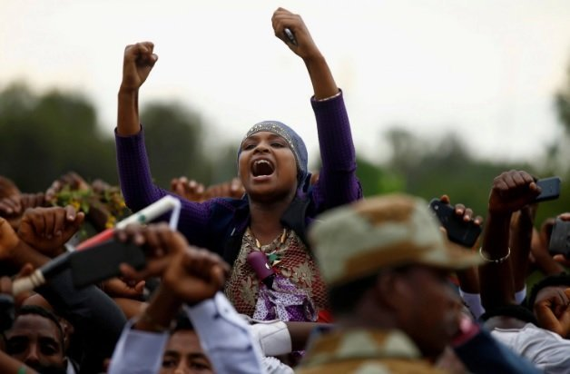 Demonstrators chant slogans while flashing the Oromo protest gesture during Irreecha, the thanksgiving festival of the Oromo people, in Bishoftu town, Oromia region, Ethiopia, on Oct. 2. (Tiksa Negeri/Reuters)