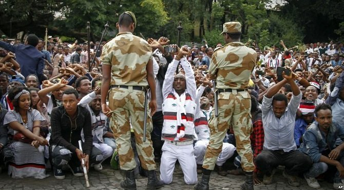 FILE - Ethiopian soldiers try to stop protesters in Bishoftu, in the Oromia region of Ethiopia. / VOA