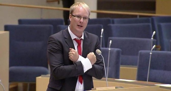Anders Österberg ,Swedish MP, showing protest sign.  source:  www. esmsweden.org