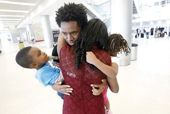 Feyisa Lilesa meeting his family at Miami International Airport. Photo : AP